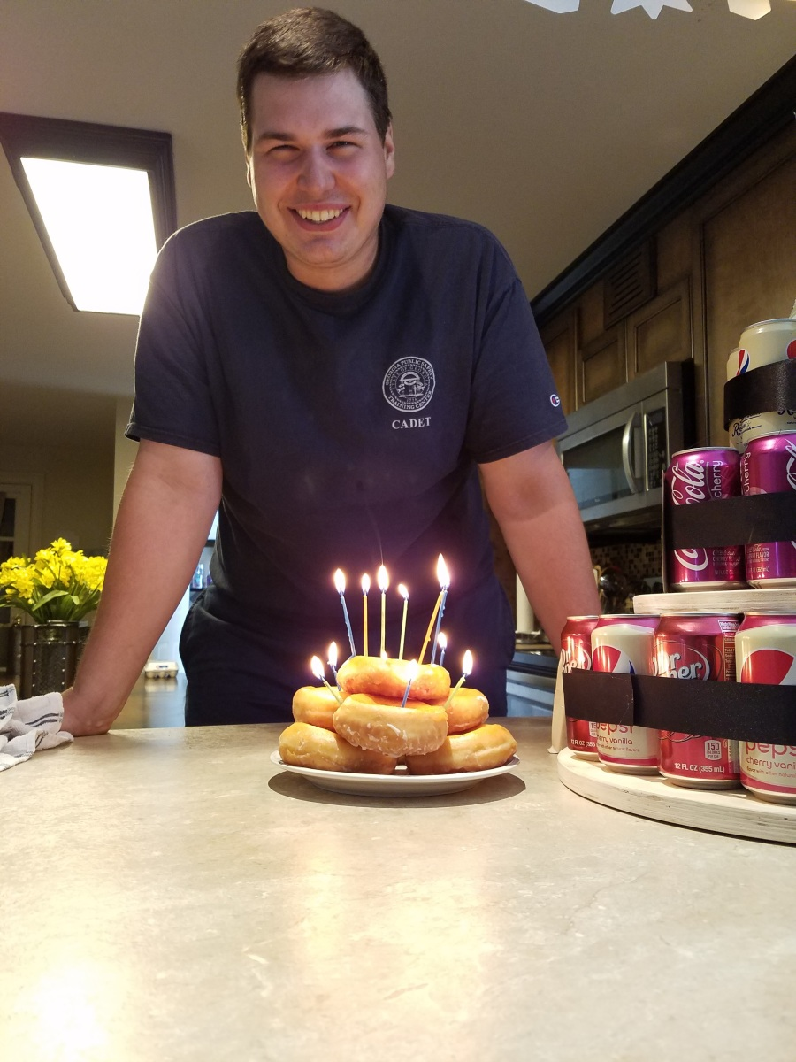 [[File:quimtons-24th-birthday.jpeg |thumb|center|upright=0.75|alt=birthday boy with doughnuts.|
